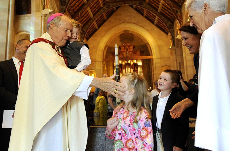 Bishop Clark greets children after Mass.