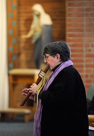 Marie Gibson plays the pentatonic flute.