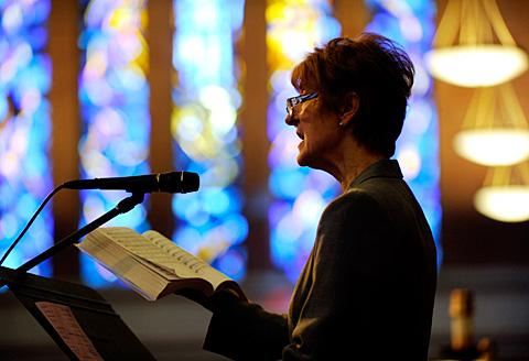 Cantor Ruth O'Brien sings during the service.