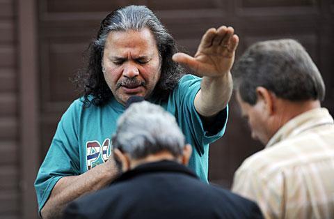 Deacon Jorge Malave prays over the preachers.
