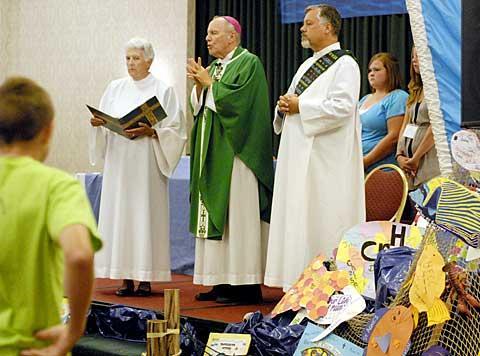 Sr. Mary Ann Binsack, Bishop Clark and Deacon Dan Pavlina.