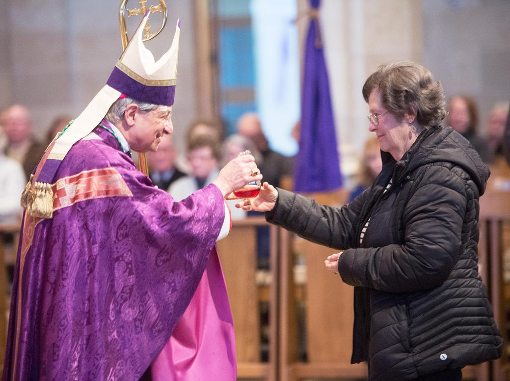 Bishop Salvatore R. Matano receives the gifts during the March 3 vigil Mass at Sacred Heart Cathedral to commemorate the March 3, 1868, founding of the Diocese of Rochester.