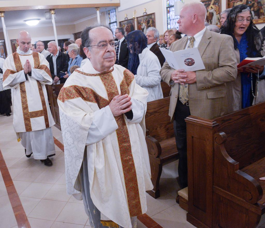 Father Ronald Antinarelli, pastor, processes into the church.(Courier Photo by John Haeger)