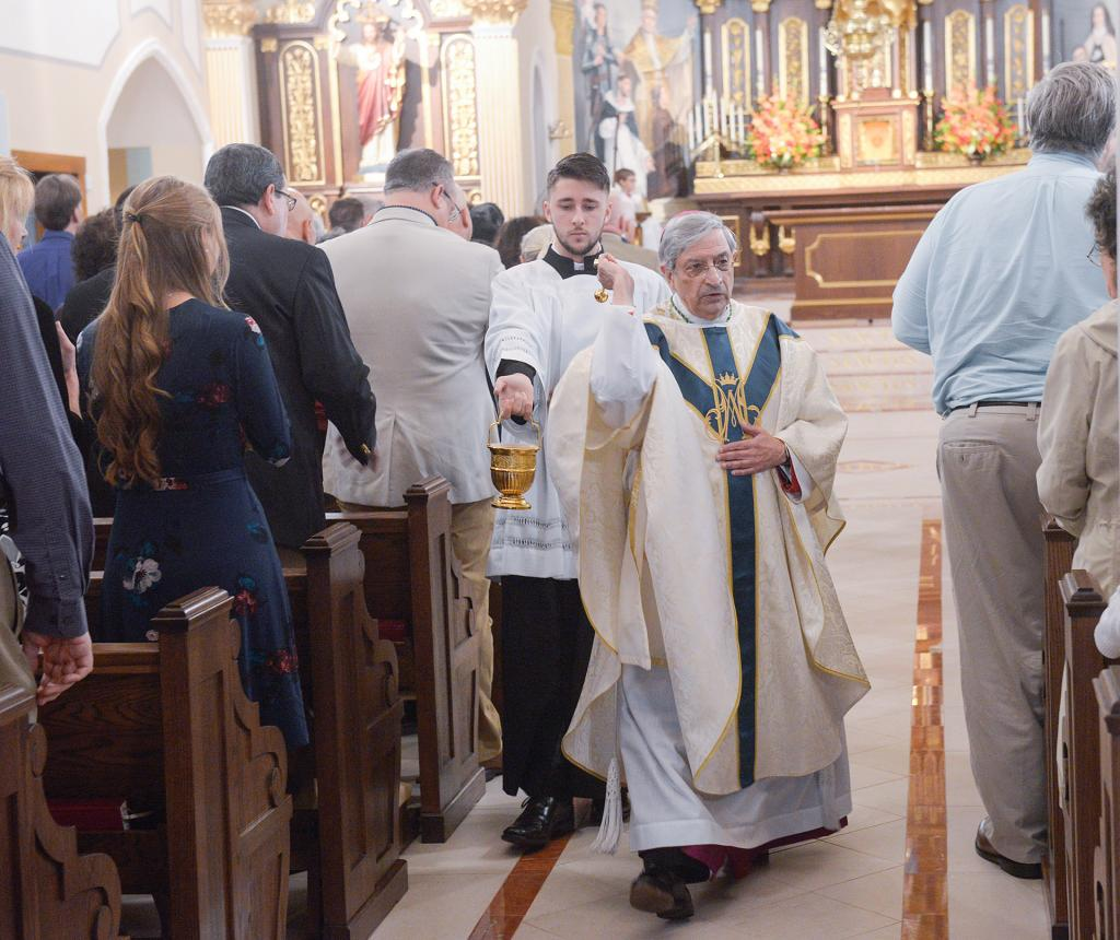 Bishop Salvatore R. Matano blesses the church. (Courier Photo by John Haeger)