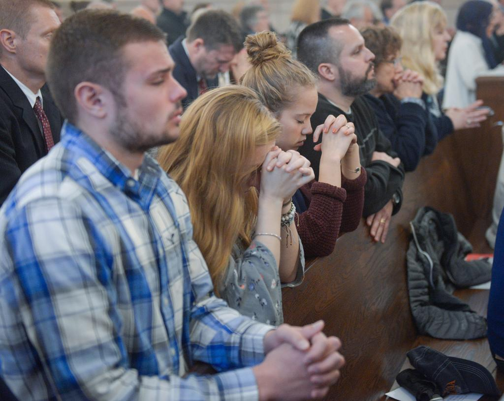 Parishioners pray during the liturgy. (Courier Photo by John Haeger)