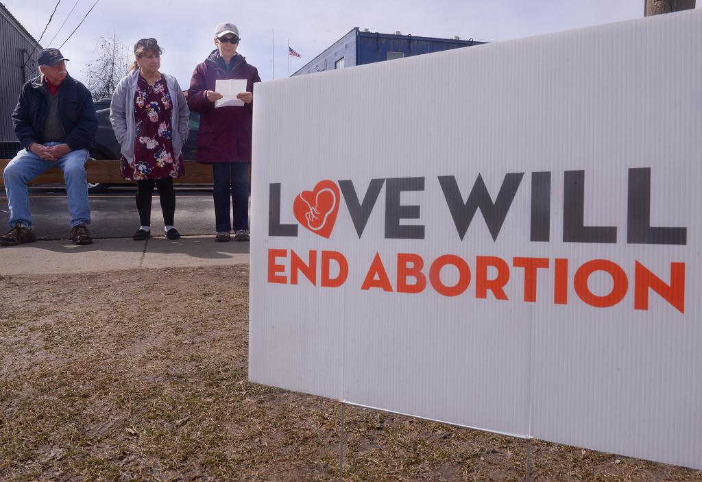 40 Days for Life participants pray across the street from Planned Parenthood in Ithaca March 27.