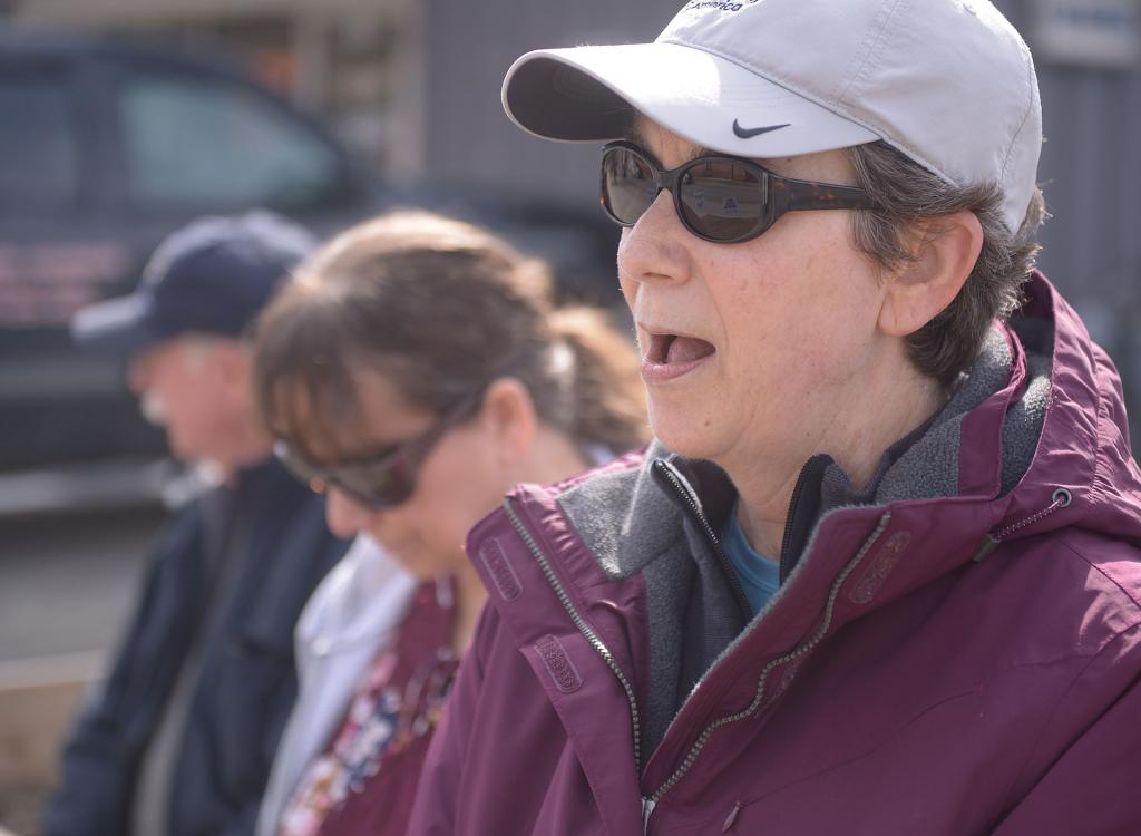 A 40 Days for Life participant leads a prayer across the street from Planned Parenthood in Ithaca March 27.