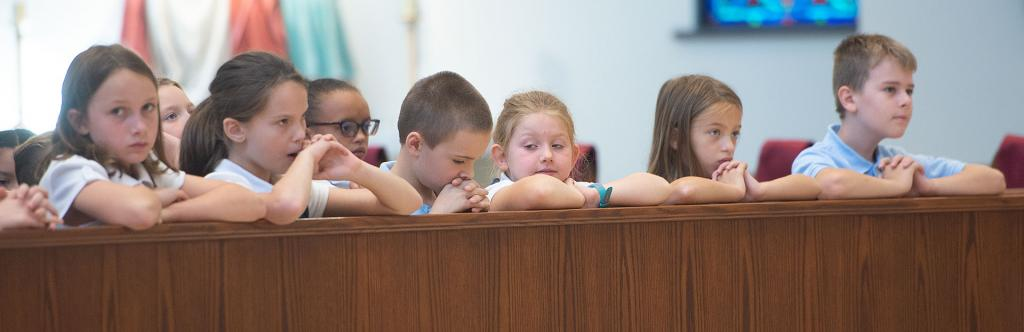 Students pray during the liturgy.