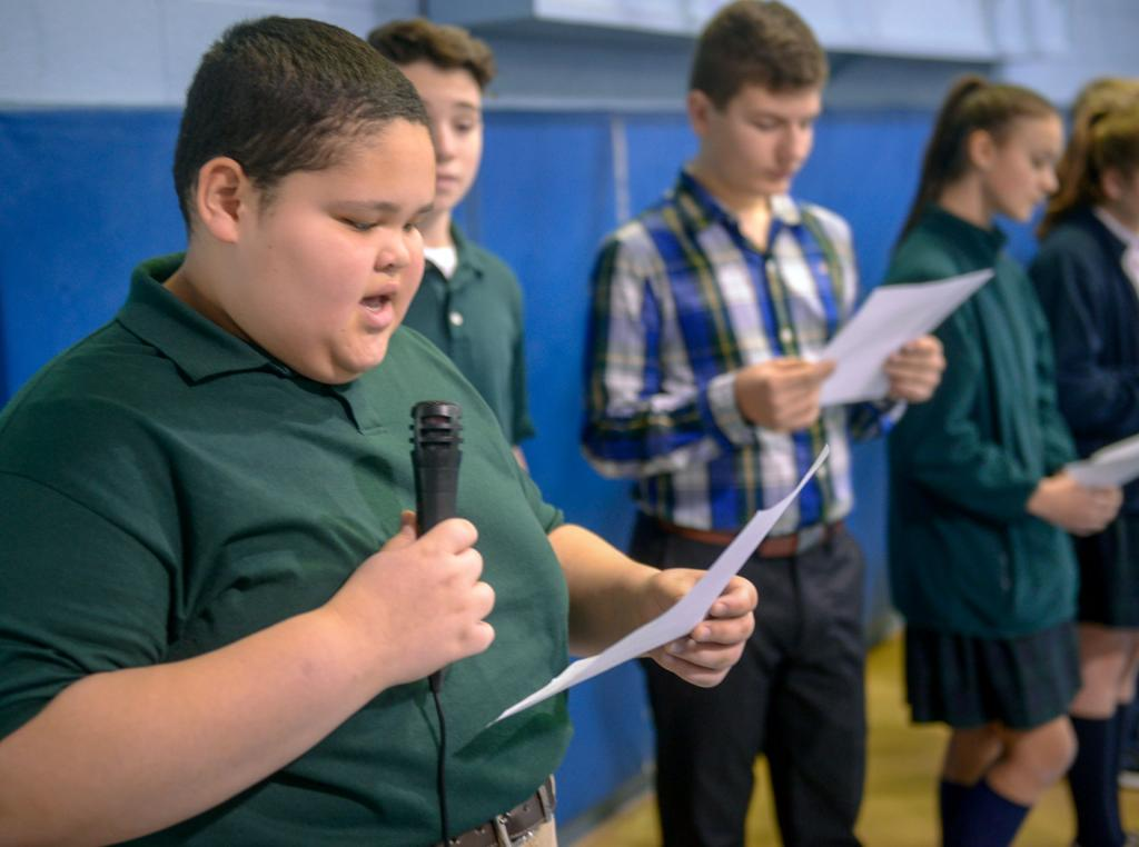 Enrique Hernandez, a seventh-grader at St. Joseph School in Auburn, takes part in a prayer service Jan. 28.