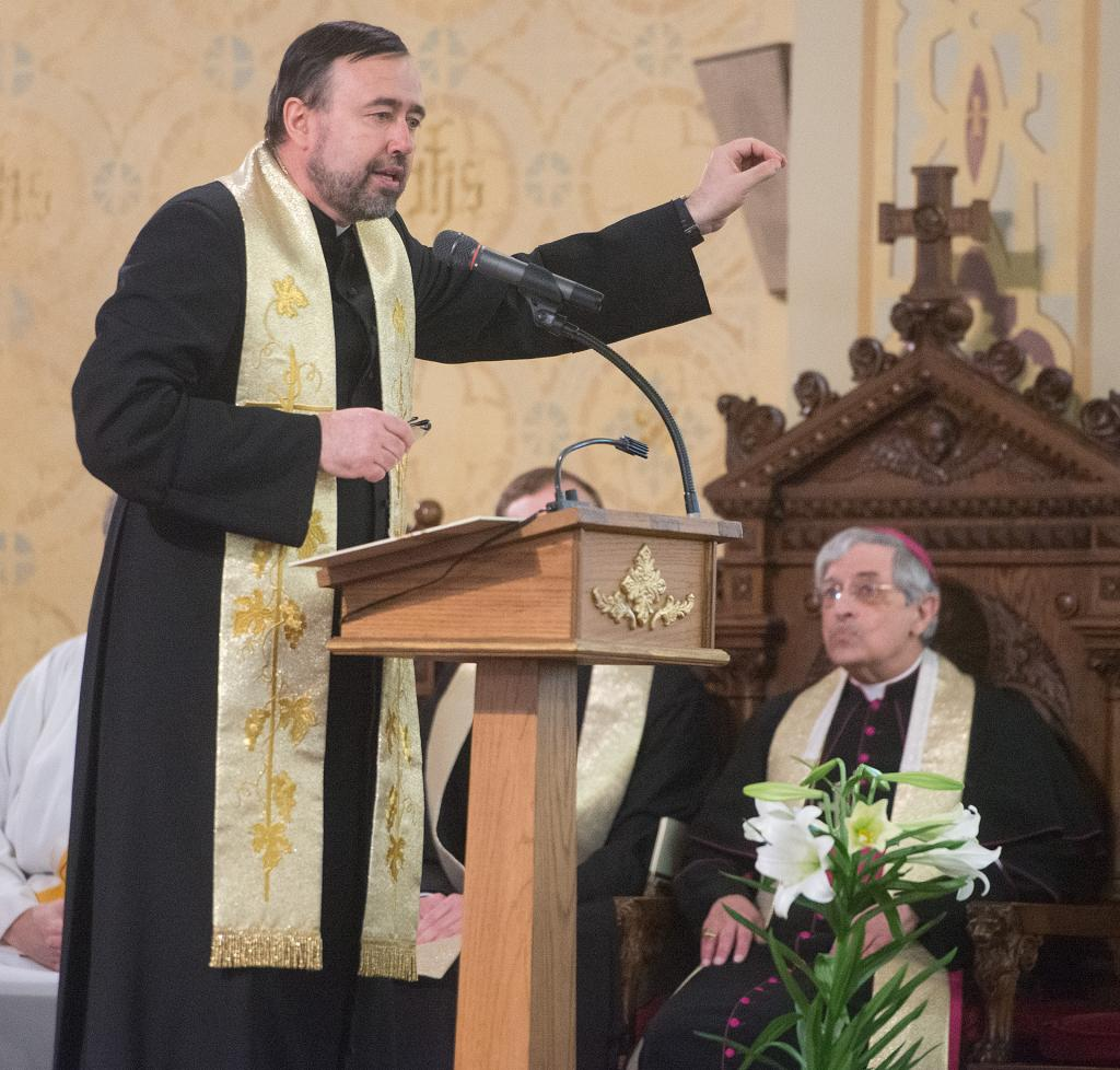 Father Roman Caly speaks during the blessing. (Courier Photo by John Haeger)