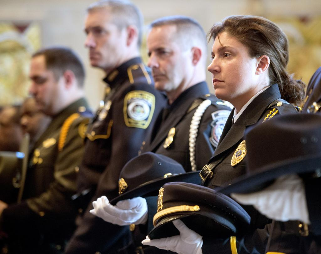 Jessica Franco of the Irondequoit Police Department and other law enforcement personnel take part in the Oct. 14 Blue Mass at Sacred Heart Cathedral.