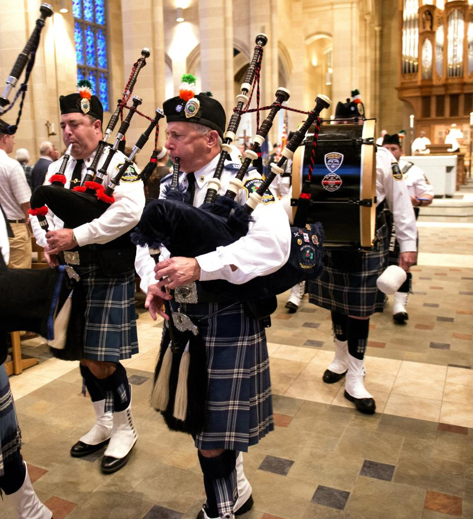 Members of Gates Keystone Club Pipes and Drums take part in the recessional at Sacred Heart Cathedral Oct. 14 at the end of the annual Blue Mass.