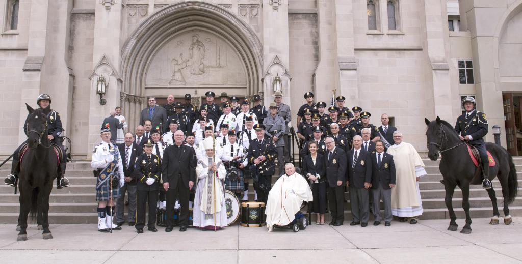 Bishop Salvatore R. Matano poses with law enforcement personal on the steps of Sacred Heart Cathedral following the Oct. 14 Blue Mass.