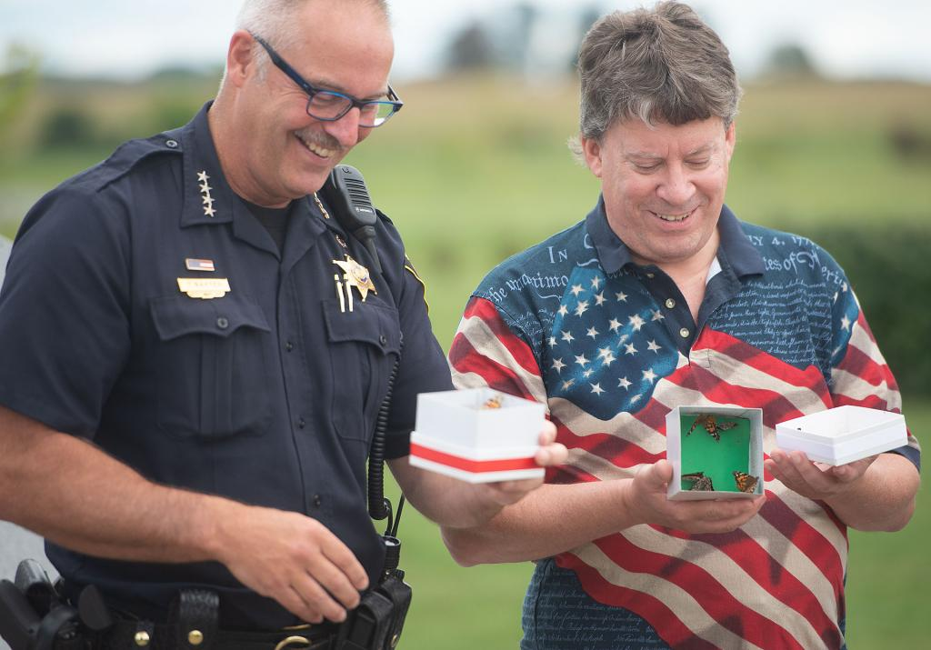 Monroe County Sheriff Tom Baxter and Town of Henrietta Supervisor Steve Schultz release butterflies.