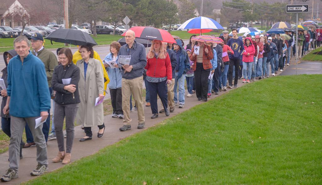 People line the sidewalk as they process to the fourth station during the Stations of the Cross in Reparation for Abortion.