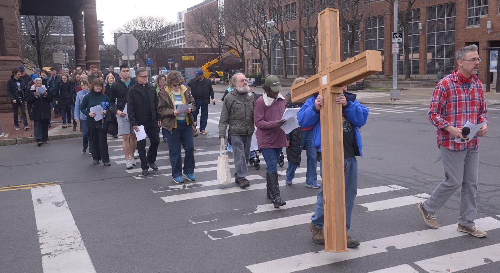 Participants take part in the Stations of the Cross organized by the House of Mercy, St. Joseph's House of Hospitality and Rochester Pax Christi.