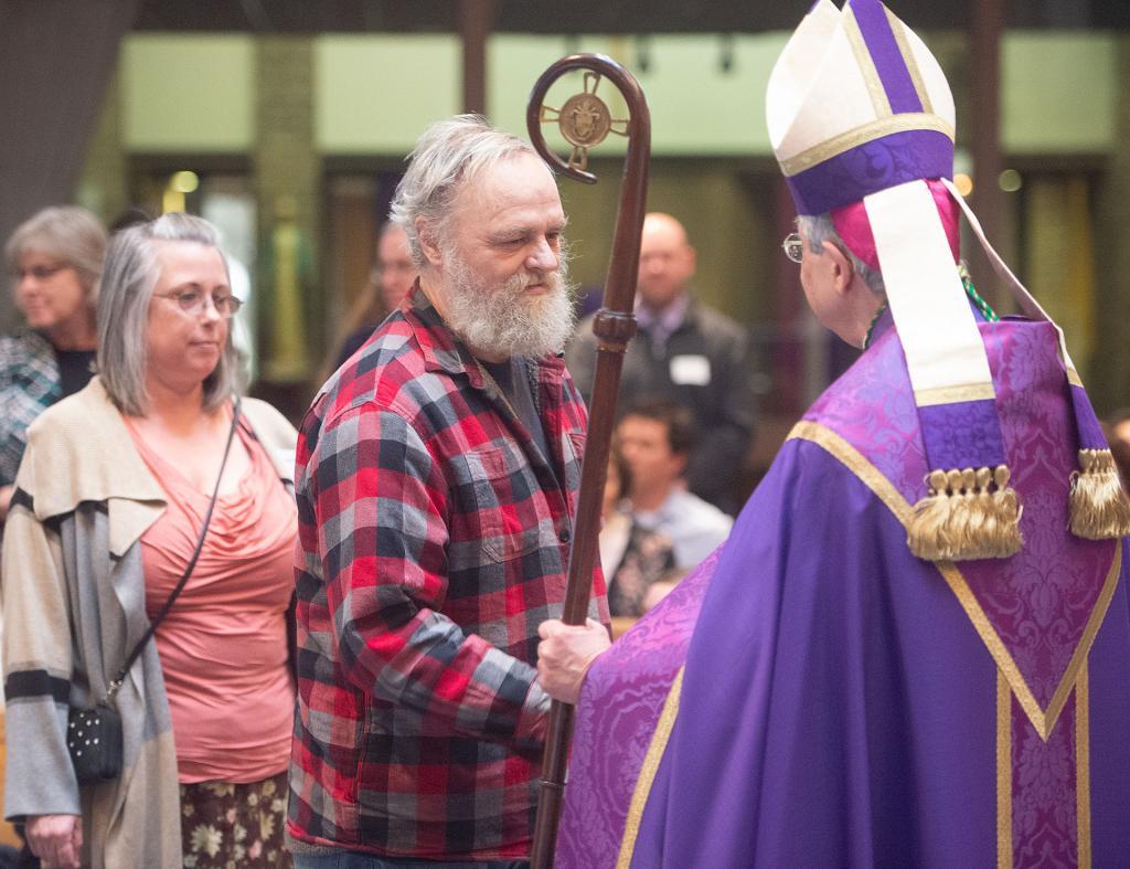 Bishop Matano greet peopleduring the ceremony.
