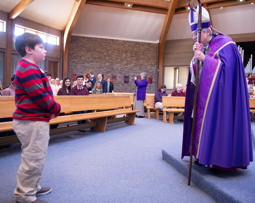 Bishop Matano speaks with ten-year-old Brier Hill of Our Lady of Lourdes Church in Elmira during the Act of Recognition.