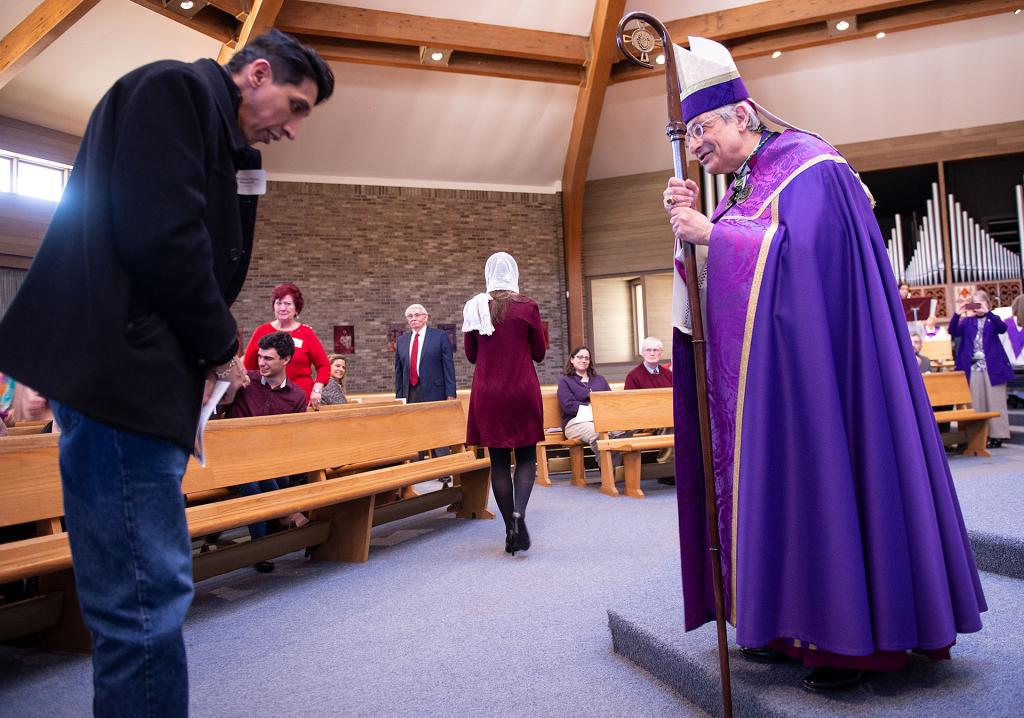Christian Woodruff of St. Mary of the Lake Church in Watkins Glen, speaks with Bishop Matano during the Act of Recognition.