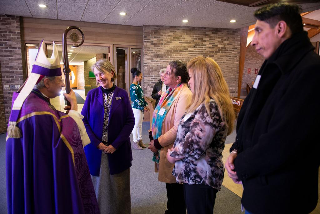 Schuyler Catholic Community RCIA Coordinator Rose Nabogis (center) joins Tammy Daniels, Jane Leszyk and Christian Woodruff of St. Mary of the Lake Church in Watkins Glen in speaking with Bishop Matano after the Rite of Election and Call to Continuing Conversion.