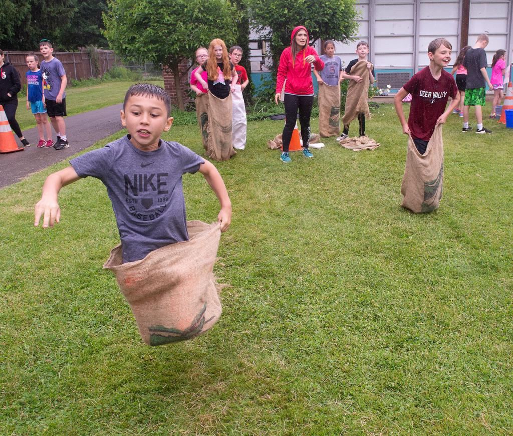 Max Norman and classmate Gavin Meier compete in a sack race at Holy Family School in Elmira June 13. (Courier photo by John Haeger)