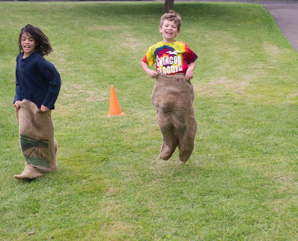Dominic Caporiccio and classmate Daniel Cowen compete in a sack race June 13 at Holy Family School in Elmira. (Courier photo by John Haeger)