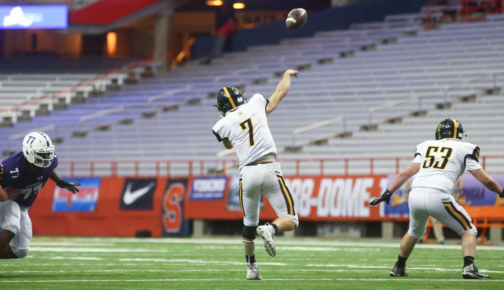 McQuaid Jesuit quarterback Joe Cairns (7) throws the ball down field.