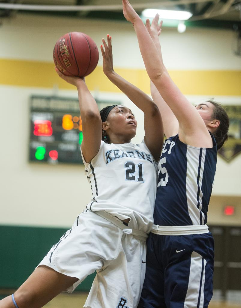 Bishop Kearney's Saniaa Wilson (21) goes up for two as Mercy's Katie Titus (25) defends in the third quarter of the Section 5 Class AA sectional championship game March 3. (Courier Photo by John Haeger)