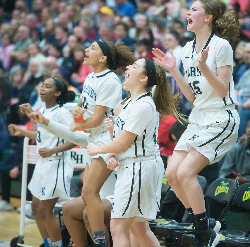 Bishop Kearney players celebrate winning the Section 5 Class AA sectional championship game March 3. (Courier Photo by John Haeger)