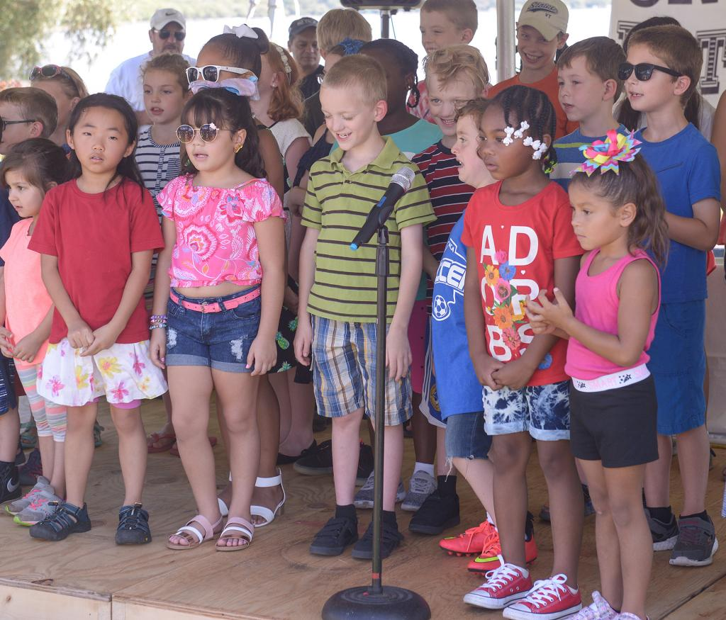 Dual-language students from West Street Elementary School and North Street Elementary School in Geneva perform songs in Spanish during Festival Latino en Geneva Sept. 15. (Courier photo by John Haeger)