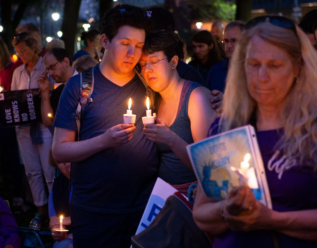 """A moment of silence is observed during """"Lights for Liberty: A Vigil to End Human Concentration Camps"""" at Washington Square Park in Rochester July 12."""