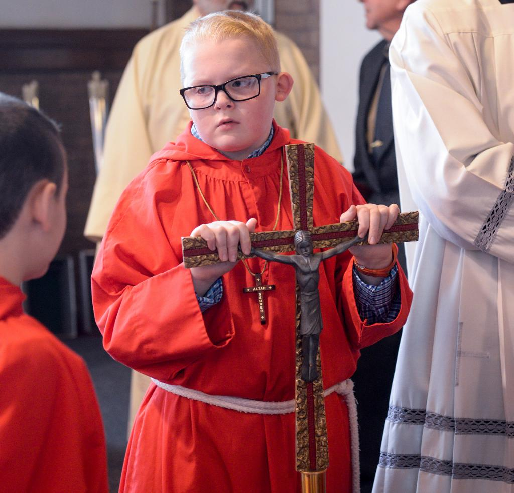 Christopher O'Neill waits for the Mass to start. (Courier photo by John Haeger)
