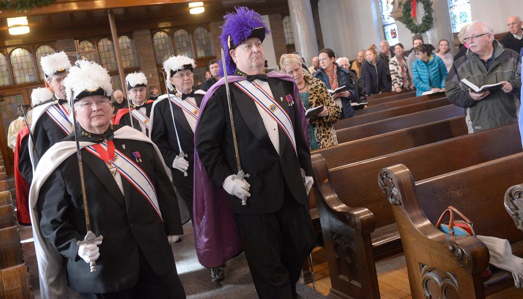 Members of the Knights of Columbus process into the church. (Courier photo by John Haeger)