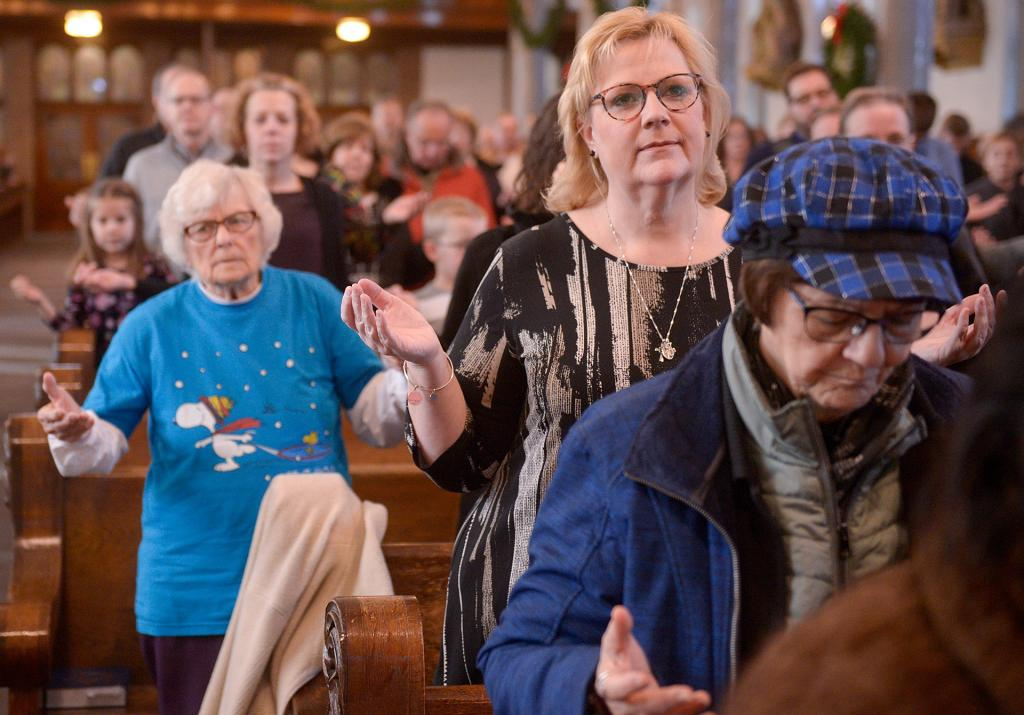 People pray during the Mass. (Courier photo by John Haeger)