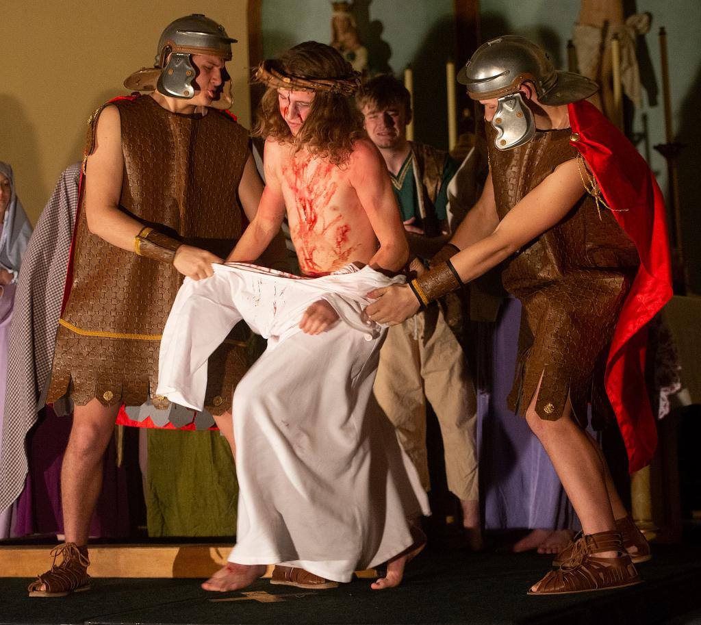 Michael and Nicholas Wasyln portray soldiers who strip Jesus' garments at the 10th station.