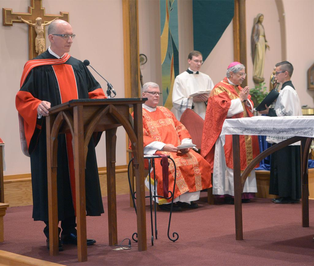 Bishop Salvatore R. Matano installs Dr. Stephen J. Loughlin as the fourth president of St. Bernard's School of Theology and Ministry during a Mass Sept. 18 at St. Jerome Church in East Rochester (Courier photo by John Haeger)