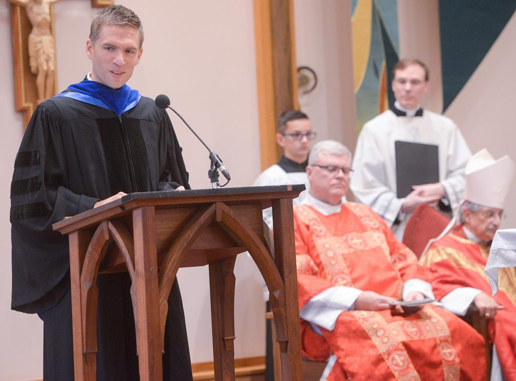 Dr. Matthew Kuhner, interim dean at St. Bernard's School of Theology and Ministry, introduces Dr. Stephen J. Loughlin during the Mass. (Courier photo by John Haeger)