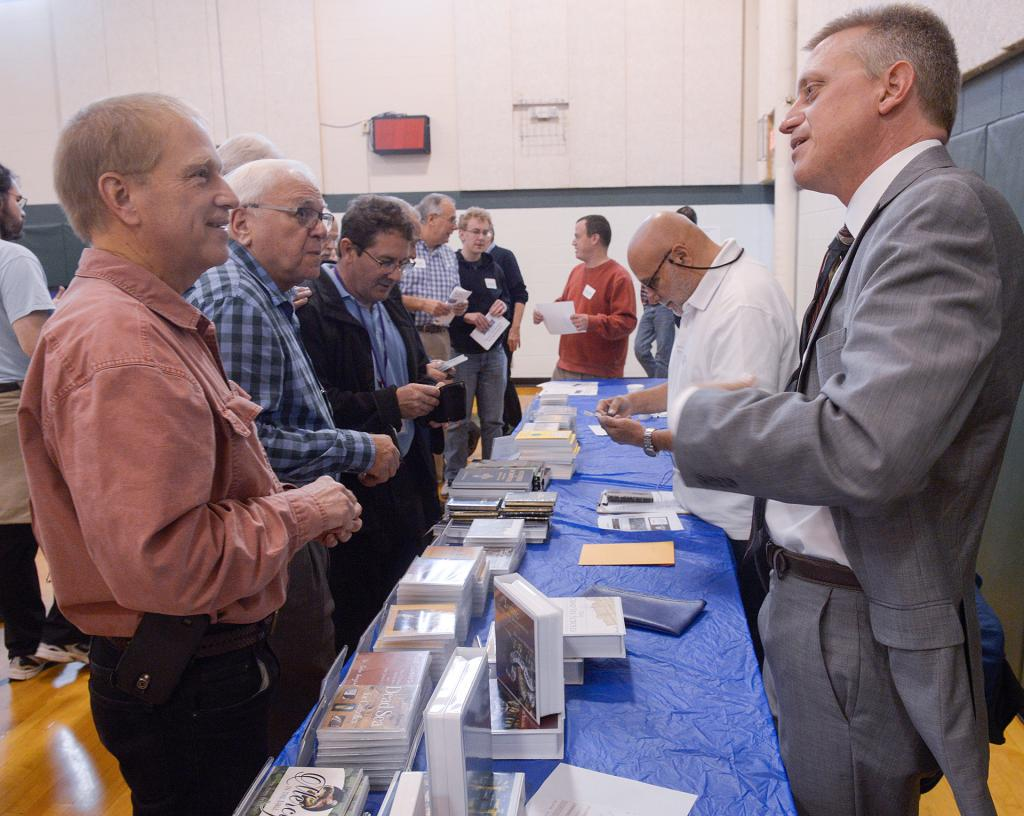 Dr. John Bergsma speaks to Deacon Thomas Uschold of Spencerport during the conference. (Courier Photo by John Haeger)