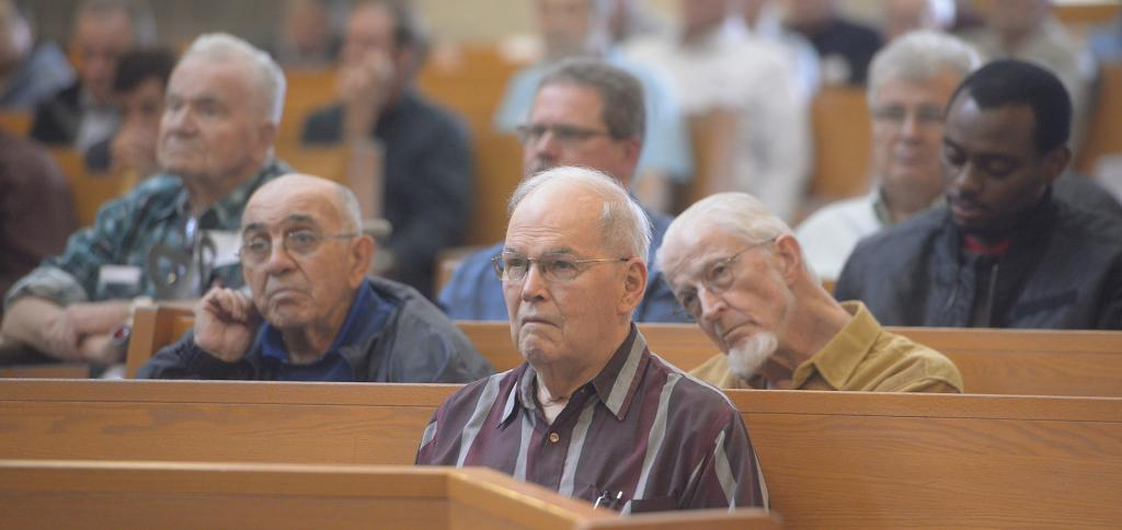 Participants listen to Dr. Marcellino D'Ambrosio's keynote address. (Courier Photo by John Haeger)