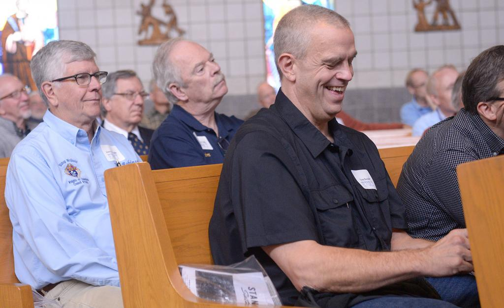 Participants listen to Dr. John Bergsma talk about his conversion to Catholicism. (Courier Photo by John Haeger)