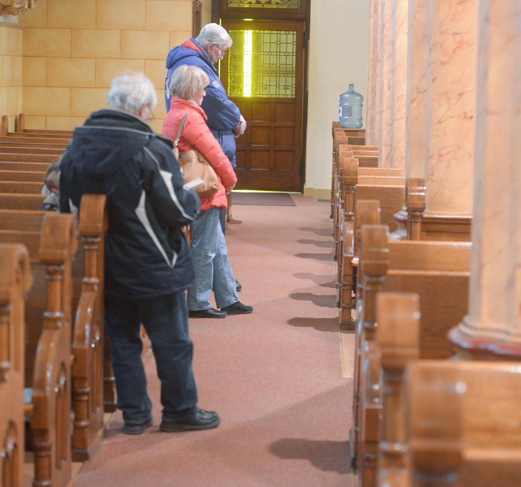 People wait in line to receive the sacrament of reconciliation March 13 at Holy Family Church in Auburn during the Day of Penance and Mercy.