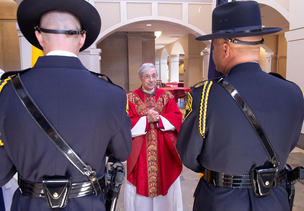 Bishop Salvatore R. Matano talks with members of the Monroe County Sheriff's Honor Guard before the start of the Red Mass Sept. 6 at Sacred Heart Cathedral in Rochester.
