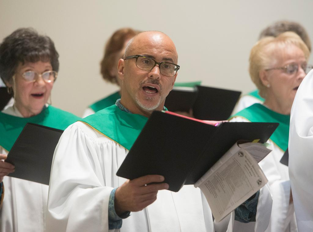 Chorus members sing during the liturgy.(Courier Photo by John Haeger)