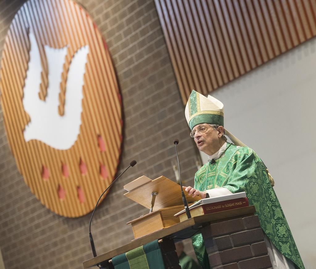 Bishop Matano gives the homily.(Courier Photo by John Haeger)