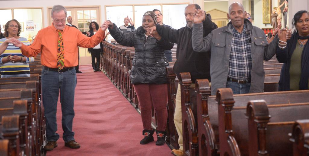 People pray during the revival. (Courier Photo by John Haeger)