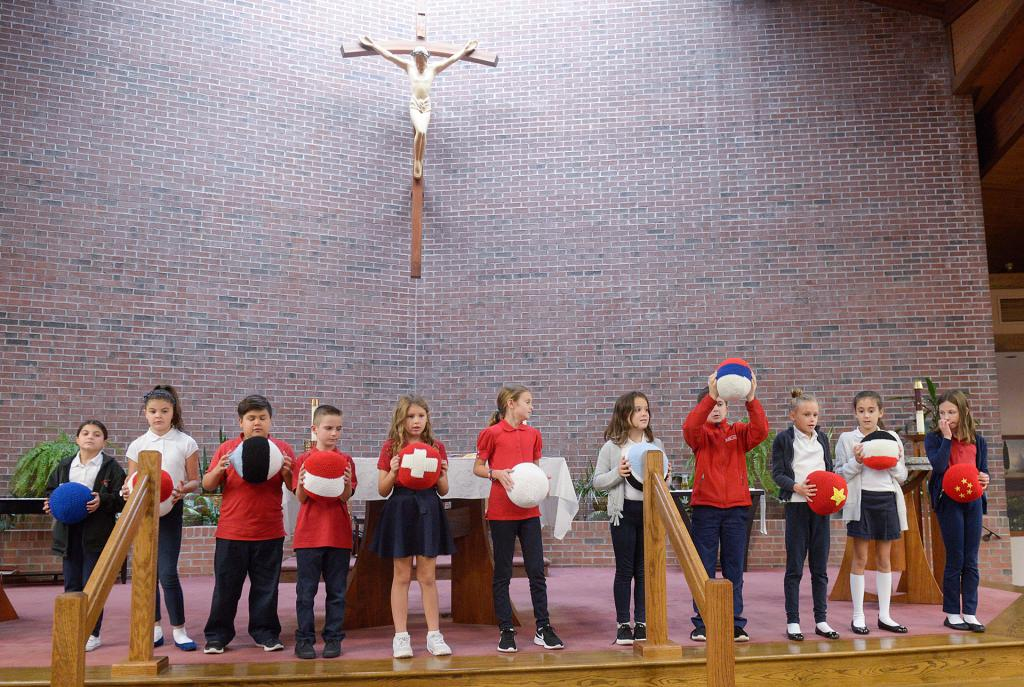 St. Lawrence School students pray the Living Rosary using The Giant Mary Queen of Peace International Rosary Oct. 12 at St. Lawrence Church in Greece.(Courier Photo by John Haeger)