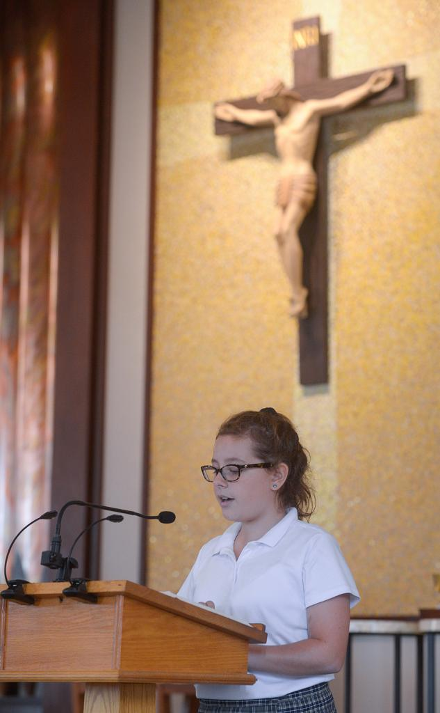 Lilliana DiSalvo participates in the Mass. (Courier Photo by John Haeger)