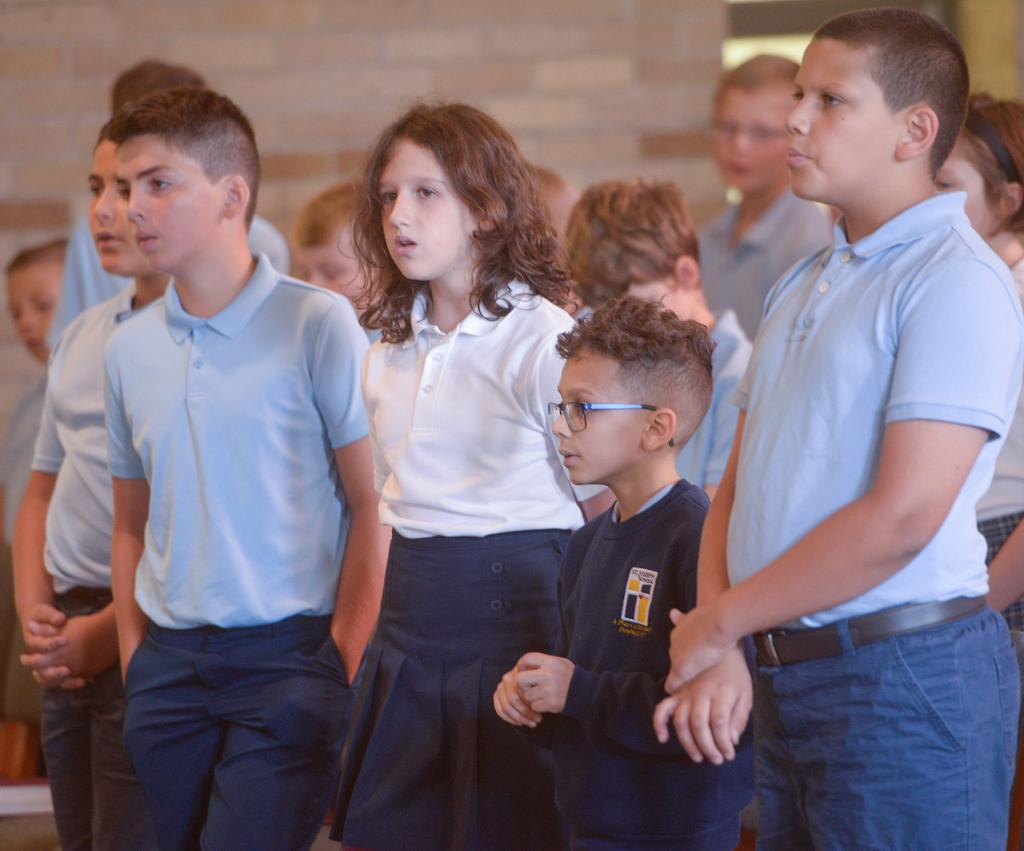 St. Joseph students sing during the liturgy. (Courier Photo by John Haeger)