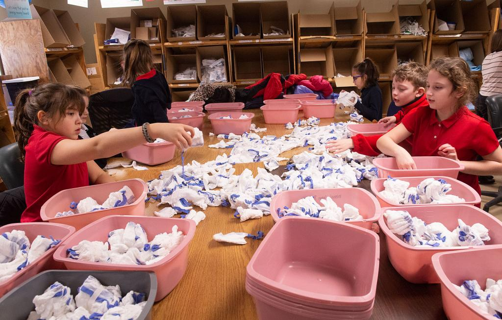 St Lawrence School third-graders sort items at InterVol. (Courier photo by John Haeger)
