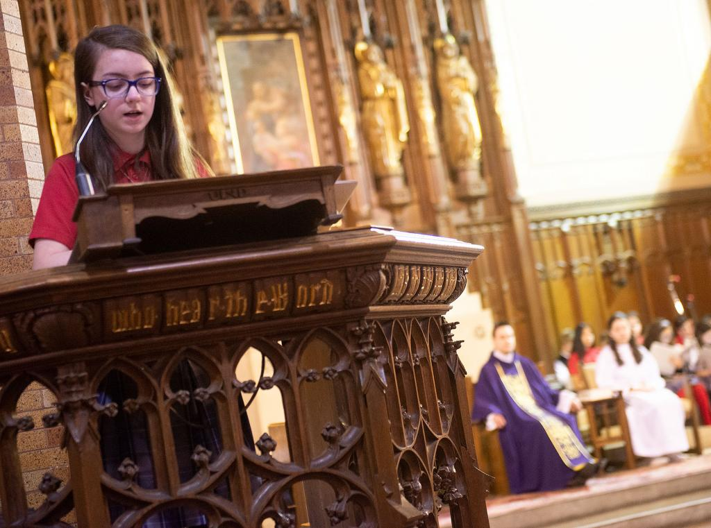 Olivia Molina, a student at St. Francis-St. Stephen School, proclaims the second reading during an Ash Wednesday liturgy at St. Stephen Church Feb. 26.